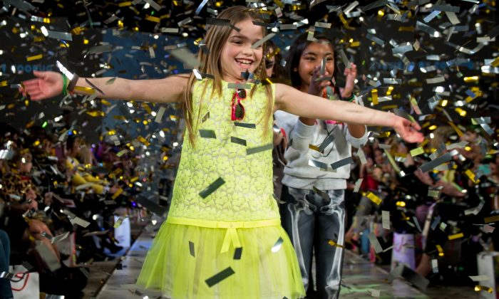 The young models celebrated the grand finale of each show with a glitter and confetti shower. The girl in front is wearing a dress from Suzanne Ermann's Spring/Summer 2013 collection. (Ian Gavan/Getty Images for AlexandAlexa.com)