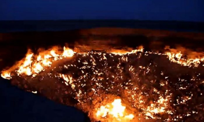 "The ""Gates of Hell"" in the desert of Turkmenistan, shown in a screenshot of a YouTube video, is a giant pit of toxic gas opened during Soviet drilling in 1971. (Screenshot via The Epoch Times)"