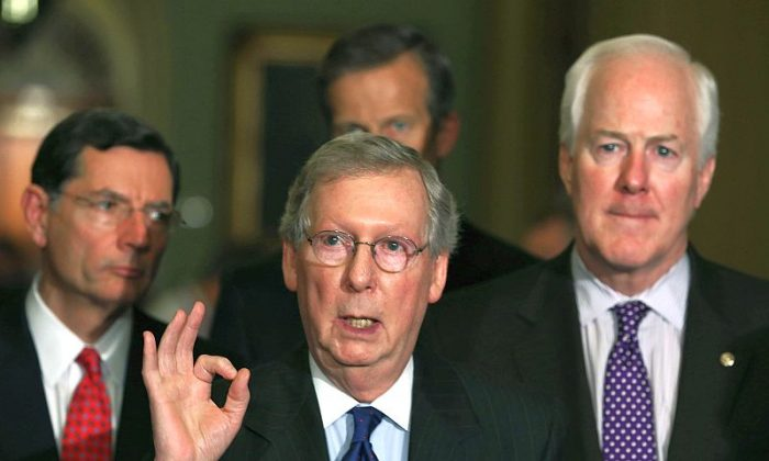 Senate Minority Leader Mitch McConnell (R-KY) (C) speaks to the media while flanked by Sen. John Barrasso (R-WY) (L), Sen. John Cornyn (R-TX) (R) and Sen. John Thune (R-SD) on April 9 in Washington, DC. The Senators spoke briefly to reporters after attending their Republican policy luncheon. (Mark Wilson/Getty Images)