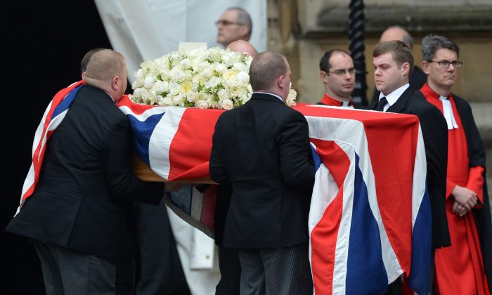 Pallbearers carry the coffin of British former prime minister Margaret Thatcher into the hearse as it leaves the chapel of St Mary Undercroft at the Houses of Parliament  (MIGUEL MEDINA,MIGUEL MEDINA/AFP/Getty Images)