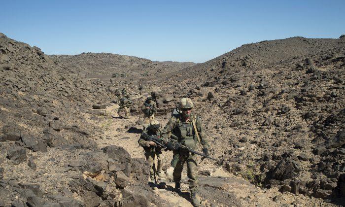 French soldiers patrol the Mettatai region in Northern Mali on March 18, 2013. (AP Photo/ECPAD, Arnaud Roine)