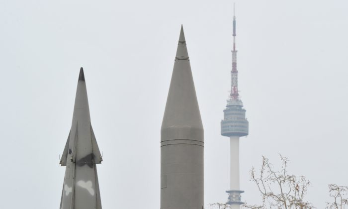 The replica of North Korea's Scud missile (C) and a decommissioned South Korean missile stand side by side at a war museum against the background of Mount Namsan in Seoul on April 10, 2013. (Kim Jae-Hwan/AFP/Getty Images)