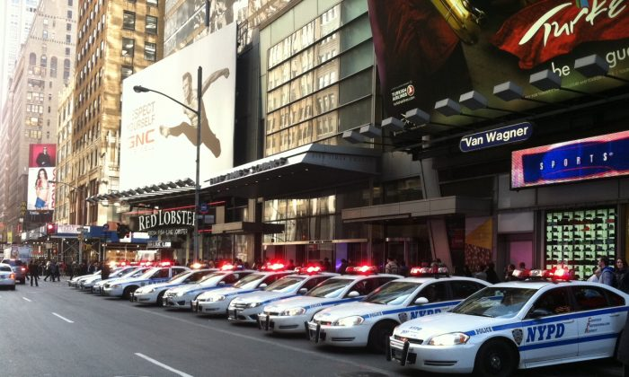 Police cars line up on 7th Ave. in front of 5 Times Square Monday afternoon. (Kristen Meriwether/The Epoch Times)