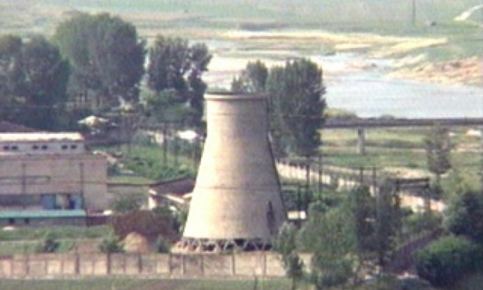 In this June 27, 2008 file photo from television, the 60-foot-tall cooling tower is seen before its demolition at the main Nyongbyon reactor complex in Nyongbyon, also known as Yongbyon, North Korea. (AP Photo/APTN, File)