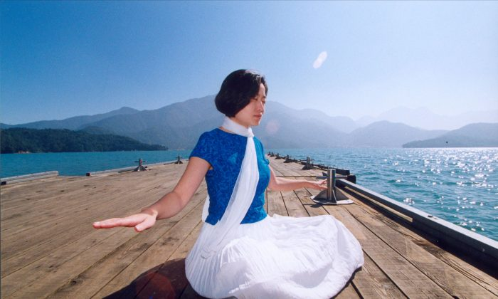 """Sitting in a state of deep tranquility is part of Falun Gong's sitting meditation, """"Strengthening divine powers."""" (Faluninfo.net)"""