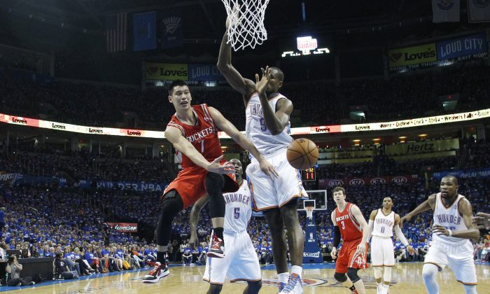 Houston Rockets guard Jeremy Lin (7) passes off in front of Oklahoma City Thunder forward Serge Ibaka (9) during Game 1 of their first-round NBA basketball playoff series in Oklahoma City, Sunday, April 21, 2013. Oklahoma City won 120-91. (AP Photo/Sue Ogrocki)