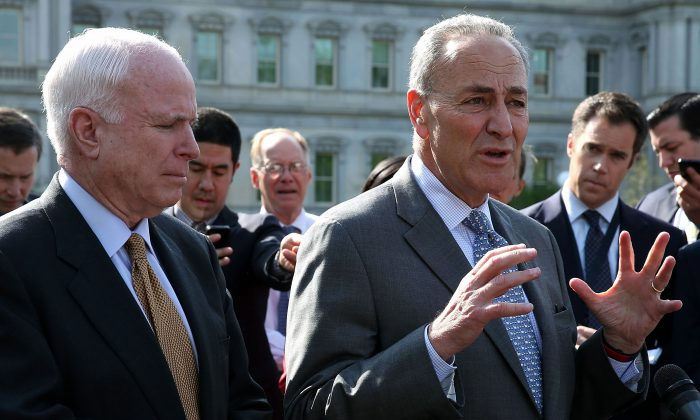 Sen. Charles Schumer (D-N.Y.) (R) and Sen. John McCain (R-Ariz.) outside the White House after briefing President Barack Obama on the contents of their new immigration proposal. (Photo by Mark Wilson/Getty Images)