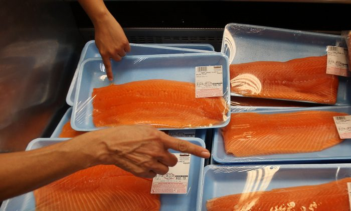 A file photo of shoppers selecting salmon in a large chain food store  in Glendale, Calif., on Aug. 19, 2008. (Photo by David McNew/Getty Images)