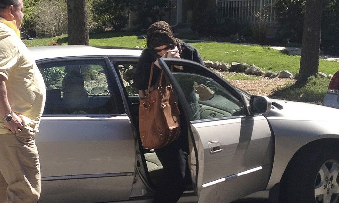 Katherine Russell Tsarnaev, center, wife of dead Boston Marathon bombing suspect Tamerlan Tsarnaev, exits a car at the home of her parents in North Kingstown, R.I. on April 21, 2013. (AP Photo/Katie Zezima)