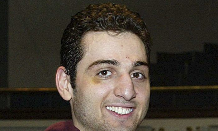 A file photo of Tamerlan Tsarnaev, after accepting the trophy for winning the 2010 New England Golden Gloves Championship on Feb. 17, 2010. (AP Photo/The Lowell Sun, Julia Malakie)