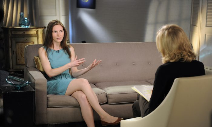 This April 9, 2013 photo released by ABC shows Amanda Knox, left, speaking during a taped interview with ABC News' Diane Sawyer in New York.   (AP Photo/ABC, Ida Mae Astute)
