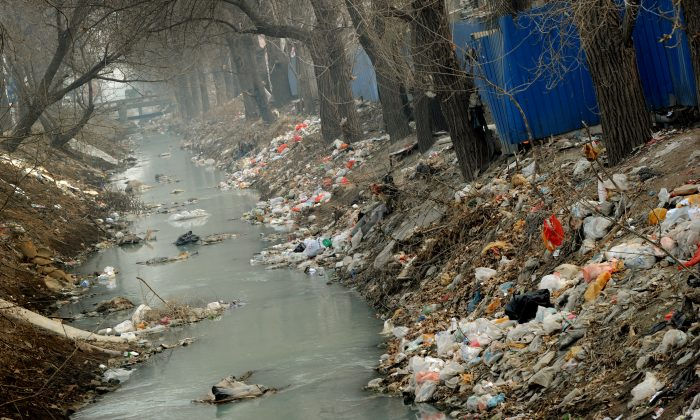 Trash clogs up a polluted canal at the edge of Beijing on March 16, 2012. (Mark Ralston/AFP/Getty Images)