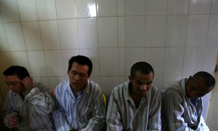 Patients wait to eat in the Kunming Mental Hospital on Dec. 1, 2007 in Kunming of Yunnan Province, southwest China. The Chinese authorities are rolling out a new mental health law, but many doubt it will really prevent the abuses that it is supposed to. (China Photos/Getty Images)