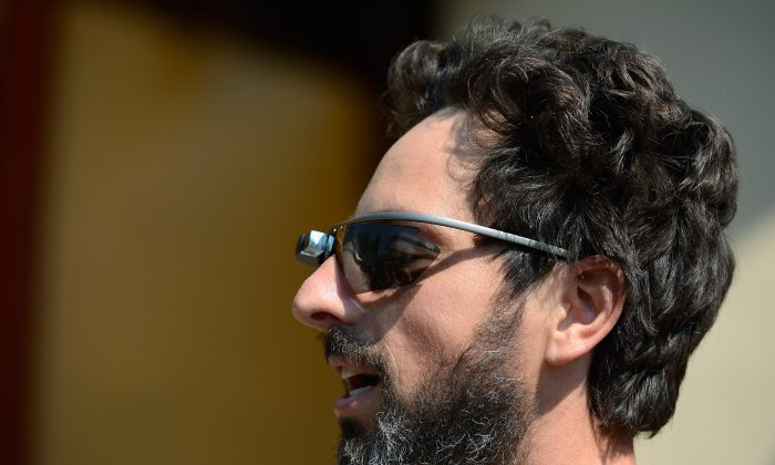 Google co-founder Sergey Brin (L) wears Project Glass prototype glasses at Allen & Company's Sun Valley Conference on July 12, 2012 in Sun Valley, Idaho. (Kevork Djansezian/Getty Images)