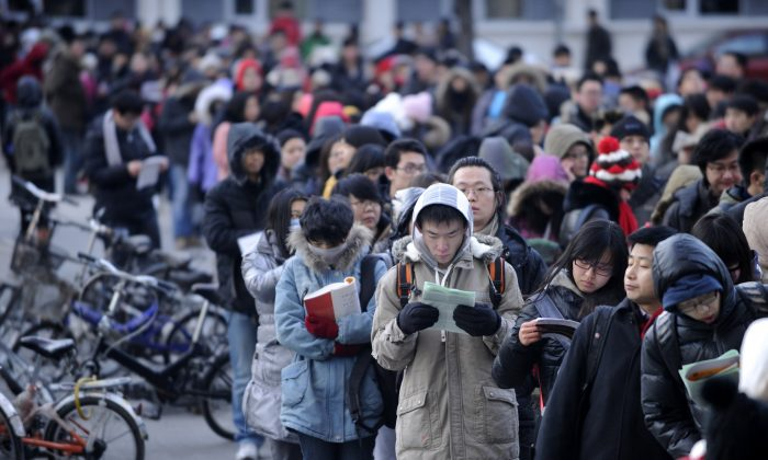 This photo, from Jan. 5, 2013, shows candidates waiting to enter into the exam room to sit the National Entrance Examination for Postgraduate (NEEP) at a university in Beijing.  A new directive is ordering local education agencies and Party organizations at universities to strengthen the ideological and political education of young university instructors. (Wang Zhao/AFP/Getty Images)