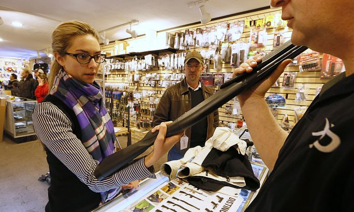 Naomi (last name withheld) looks at a shotgun to purchase for home protection at the 'Get Some Guns & Ammo' shooting range on January 15, 2013 in Salt Lake City, Utah. (George Frey/Getty Images)