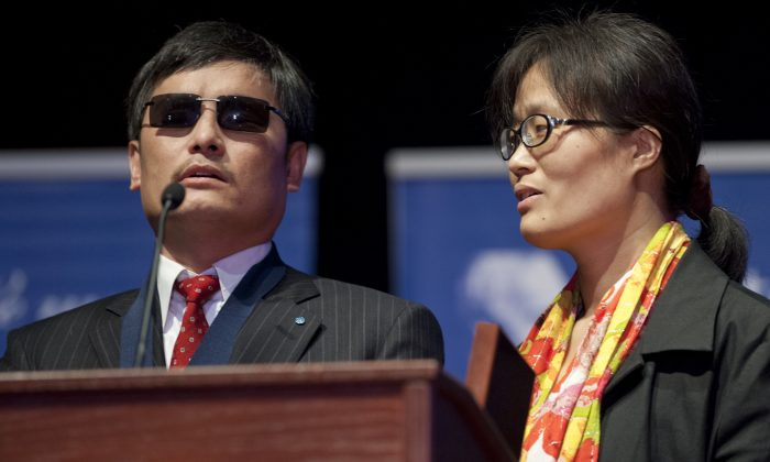 Chinese activist lawyer Chen Guangcheng speaks alongside his wife, Yuan Weijing, after being presented with the Tom Lantos Human Rights Prize during a ceremony in Washington D.C. on Jan. 29, 2013. U.S. congressional leaders have responded to Chen's pleas for help to stop the persecution of his relatives in mainland China. (Saul Loeb/AFP/Getty Images)
