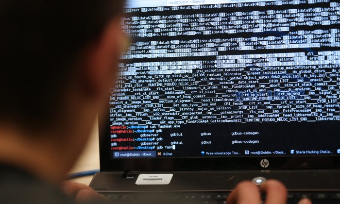 A student from an engineering school attends the first edition of the Steria Hacking Challenge in Meudon, Paris on March 16, 2013. (Thomas Samson/AFP/Getty Images)
