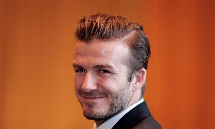 British football player David Beckham looks on during his meets Fans at China World Trade Center Tower 3 on March 24, 2013 in Beijing, China. (Lintao Zhang/Getty Images)