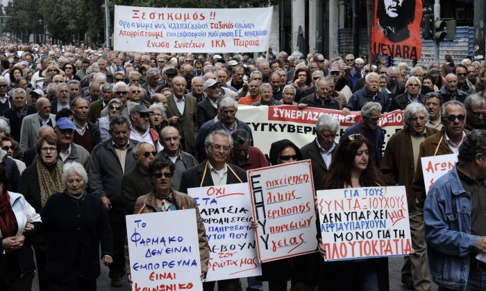 Pensioners march in central Athens during an anti-austerity demonstration on April 19, 2013. Six years of recession in Greece are having an impact on people's health, increasing the risk of psychiatric and somatic disorders. (Giorgos Nikolaidis/AFP/Getty Images)