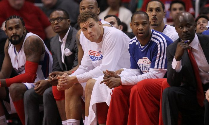 Blake Griffin #32 (center, in white) of the Los Angeles Clippers watches from the bench after leaving the game with an ankle injury against the Memphis Grizzlies during Game Five of the Western Conference Quarterfinals of the 2013 NBA Playoffs at Staples Center on April 30, 2013 in Los Angeles, California. (Stephen Dunn/Getty Images)