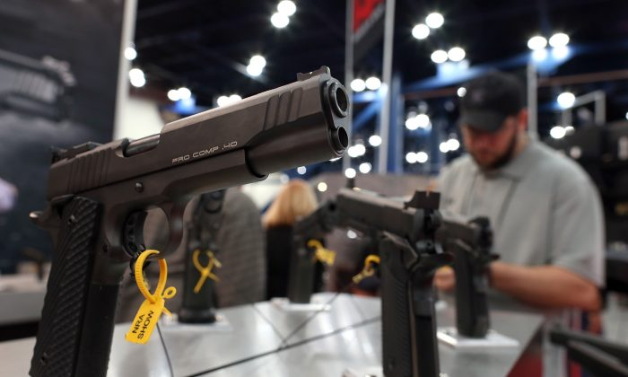 Handguns are displayed in the Para booth during the 2013 NRA Annual Meeting and Exhibits at the George R. Brown Convention Center in Houston, Texas on May 5, 2013. (Justin Sullivan/Getty Images)