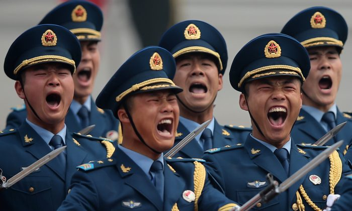 Troops march during a welcoming ceremony outside the Great Hall of the People on May 6, 2013 in Beijing, China, held for the visiting Palestinian President. The Department of Defense issued a report that for the first time identified the PRC as the source of cyber espionage against U.S. assets. (Photo by Feng Li/Getty Images)