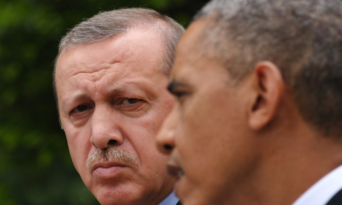 Turkish Prime Minister Recep Tayyip Erdogan (L) watches as US President Barack Obama speaks during a joint press conference in the Rose Garden of the White House on May 16, 2013 in Washington, DC. (Mandel Ngan/AFP/Getty Images)