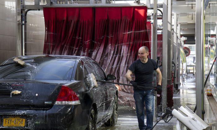 Miguel Portillo, seen washing a car at Jomar Car Wash in Flushing on April 26, 2013. (Samira Bouaou/Epoch Times)