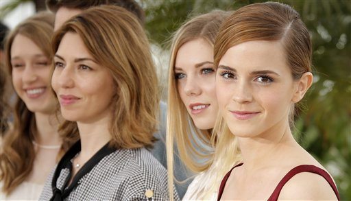 From right, actors Emma Watson, Claire Julien, director Sofia Coppola, and actor Taissa Fariga pose for photographers during a photo call for the film The Bling Ring at the 66th international film festival, in Cannes, southern France, Thursday, May 16, 2013. (AP Photo/Francois Mori)