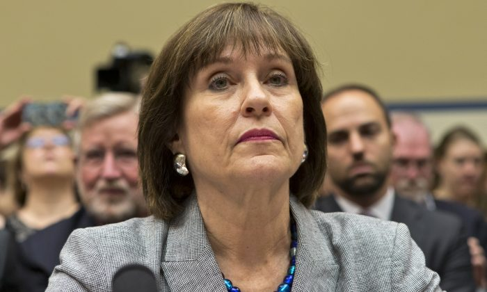 In this May 22, 2013, photo, Lois Lerner listens on Capitol Hill in Washington. A day after she refused to answer questions at a congressional hearing, Lerner has been replaced as director the Internal Revenue Service division that oversaw agents who targeted tea party groups.  (AP Photo/J. Scott Applewhite)