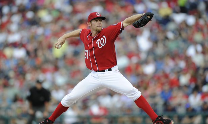 Washington Nationals starter Stephen Strasburg delivers a pitch during the fifth inning of a baseball game against the Chicago Cubs, Saturday, May 11, 2013, in Washington. (AP Photo/Nick Wass)