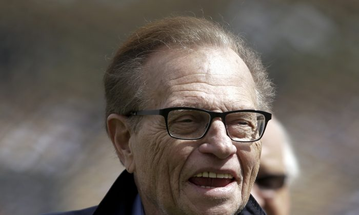 """This April 1, 2013, photo shows talk show host Larry King attending a season-opening baseball game between the Los Angeles Dodgers and the San Francisco Giants in Los Angeles.  King will host a political talk show beginning next month. The new program, """"Politics with Larry King,"""" will air on the RT America network, a global, English-language channel based in Russia, the network announced Wednesday, May 29, 2013. (AP Photo/Jae C. Hong)"""