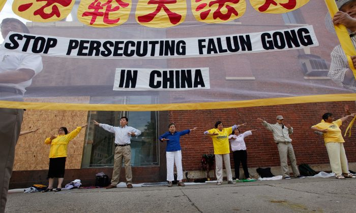 Falun Gong practitioners demonstrate in front of the Chinese Consulate in Chicago, Ill., in this file photo. Both Falun Gong practitioners and women face persecution in China today. (Scott Olson/Getty Images)