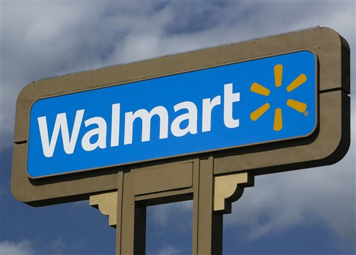 An outdoors sign for Wal-Mart is seen in Duarte, Calif. Tuesday, May 28, 2013. Recent studies suggest that the company's low wages are costing tax payers billions in health and other benefits. (AP Photo/Damian Dovarganes)
