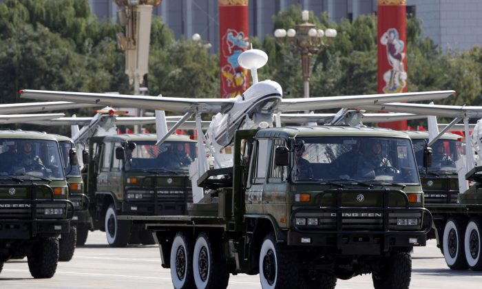A truck loaded with the Chinese made drone, the ASN-207, takes part in a military parade on Oct. 1, 2009. (Vincent Thian/AP)