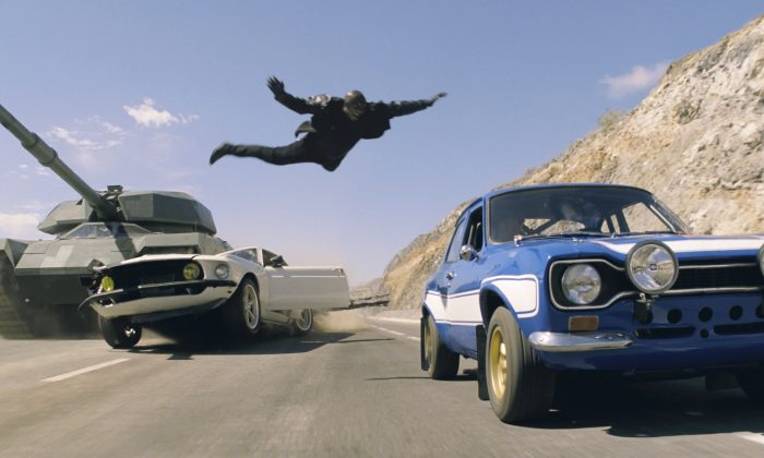 """Roman (Tyrese Gibson) makes a death-defying leap in the action-thriller """"Fast & Furious 6."""" Gibson was being a bad father by not spending time with his daughter following a delay in """"Fast & Furious 7"""" filming, the mother of the daughter says in court filings. (Courtesy of Universal Pictures)"""