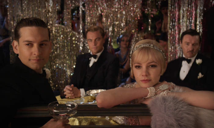 "(L-R) Nick Carraway played by Tobey Maguire, Jay Gatsby (Leonardo DiCaprio), Daisy Buchanan (Cary Mulligan) and Tom Buchanan (Joel Edgerton) the romantic drama ""The Great Gatsby."" (Warner Bros. Pictures)"