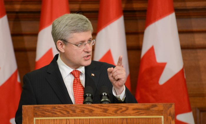 Prime Minister Stephen Harper told his caucus that the Conservatives are the party of accountability and Conservative MPs and Senators better act that way during a meeting Tuesday, May 21, 2013. (Matthew Little/The Epoch Times)