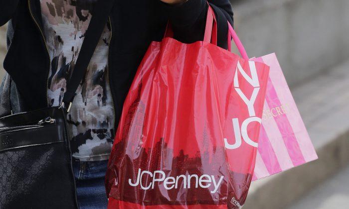 A shopper carries a J.C. Penney bag, in New York, Tues., April 9, 2013. (Mark Lennihan/AP Photo)