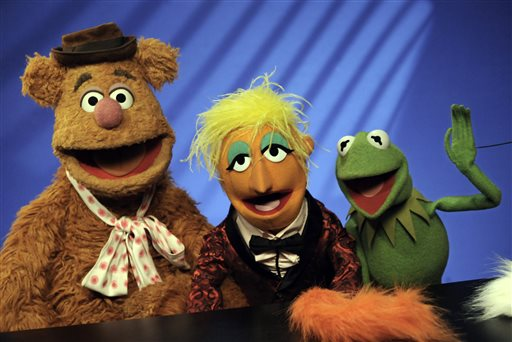 "In this Nov. 24, 2008 file photo, Muppets Fozzie Bear, left, a Whatnot, center, and Kermit the Frog make a television appearance in New York. Kermit, Miss Piggy, Bert and Ernie of ""Sesame Street"" fame, the stars of ""Fraggle Rock"" and other puppets, costumes and items from throughout Muppets creator Jim Henson's career have been donated to the Museum of the Moving Image, which is building a new gallery to house them, the institution announced Tuesday, May 21, 2013.(AP Photo/Richard Drew"