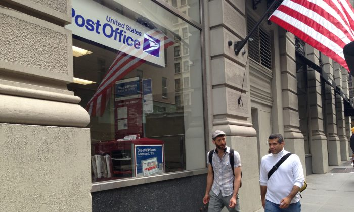 People walk by the newly-opened post office near the Madison Square Park. (Ivan Pentchoukov/The Epoch Times)