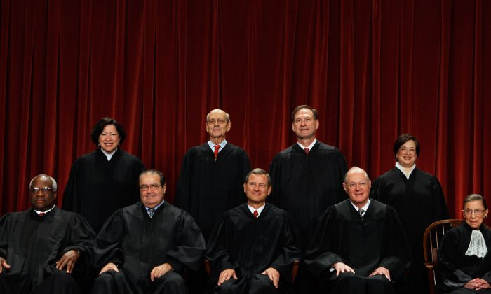 U.S. Supreme Court members (first row L-R) Associate Justice Clarence Thomas, Associate Justice Antonin Scalia, Chief Justice John Roberts, Associate Justice Anthony Kennedy, Associate Justice Ruth Bader Ginsburg, (back row L-R) Associate Justice Sonia Sotomayor, Associate Justice Stephen Breyer, Associate Justice Samuel Alito and Associate Justice Elena Kagan pose for photographs in the East Conference Room at the Supreme Court building October 8, 2010 in Washington, DC. This is the first time in history that three women are simultaneously serving on the court. (Chip Somodevilla/Getty Images)