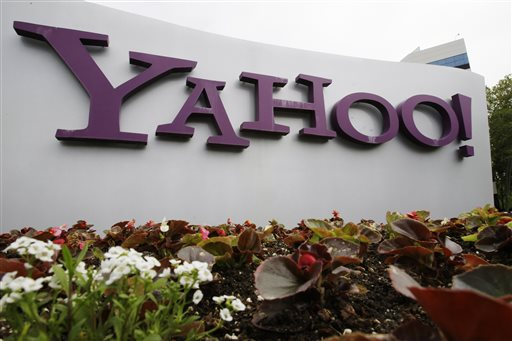 """In this April 18, 2011 file photo, the Yahoo logo is displayed outside of the offices in Santa Clara, Calif. Yahoo is shutting down Maps and a few other products in a June """"spring cleaning"""". (AP Photo/Paul Sakuma, File)"""