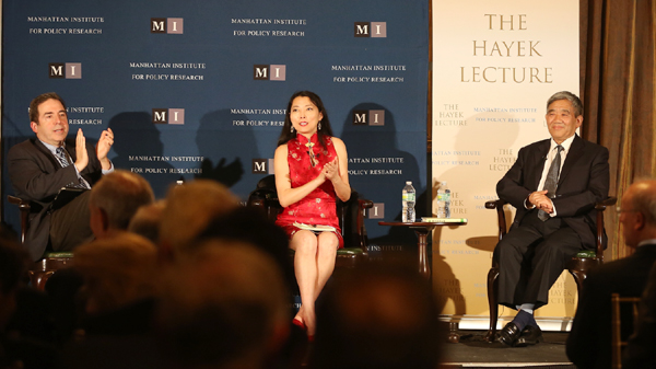 Chinese author Yang Jisheng (R) attends the Hayek Prize forum at the Manhattan Institute with interpreter Rose Tang (C) and moderator Russell Roberts (L), a research fellow at Hoover Institute. At the event, Yang Jisheng said that while the Chinese authorities acknowledge that there was a great famine, they blame it on natural causes and foreign creditors. (Du Guohui/The Epoch Times)