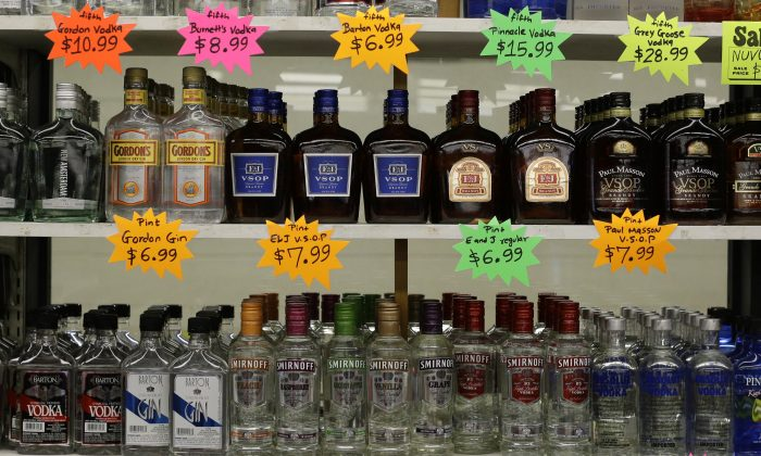 Liquor bottles in a super market in Baltimore in this file photo. Despite record stimulus measures, consumer prices have hardly increased.(AP Photo/Patrick Semansky)