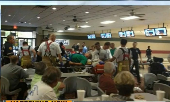 A screenshot of WPTV shows the inside of the bowling alley.