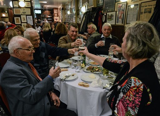In this March 16, 2013 file photo, people toast with beer and other drinks. (AP Photo/File)