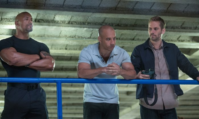 "Dwayne Johnson, left, Vin Diesel, center, and Paul Walker in a scene from ""Fast & Furious 6."" (AP Photo/Universal Pictures, Giles Keyte)"