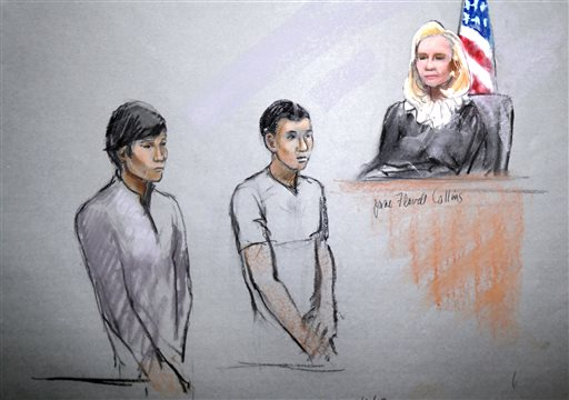 This courtroom sketch signed by artist Jane Flavell Collins shows defendants Dias Kadyrbayev, left, and Azamat Tazhayakov appearing in front of Federal Magistrate Marianne Bowler at the Moakley Federal Courthouse in Boston on Wednesday, May 1, 2013.  The two college friends of Boston Marathon bombing suspect Dzhokhar Tsarnaev, and another man, were arrested and charged with removing a backpack containing hollowed-out fireworks from Tsarnaev's dorm room. (AP Photo/Jane Flavell Collins)